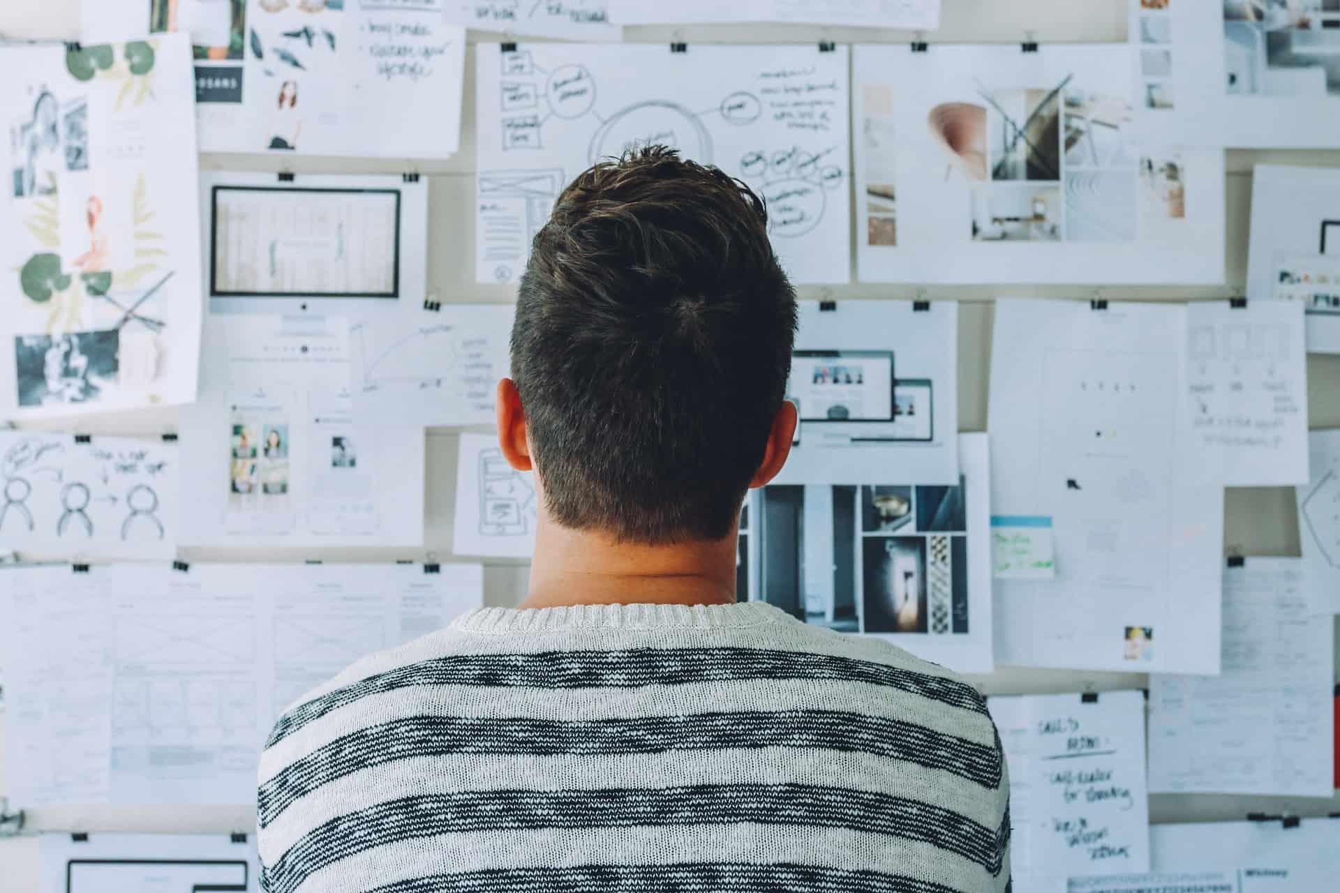 Man looking at designs