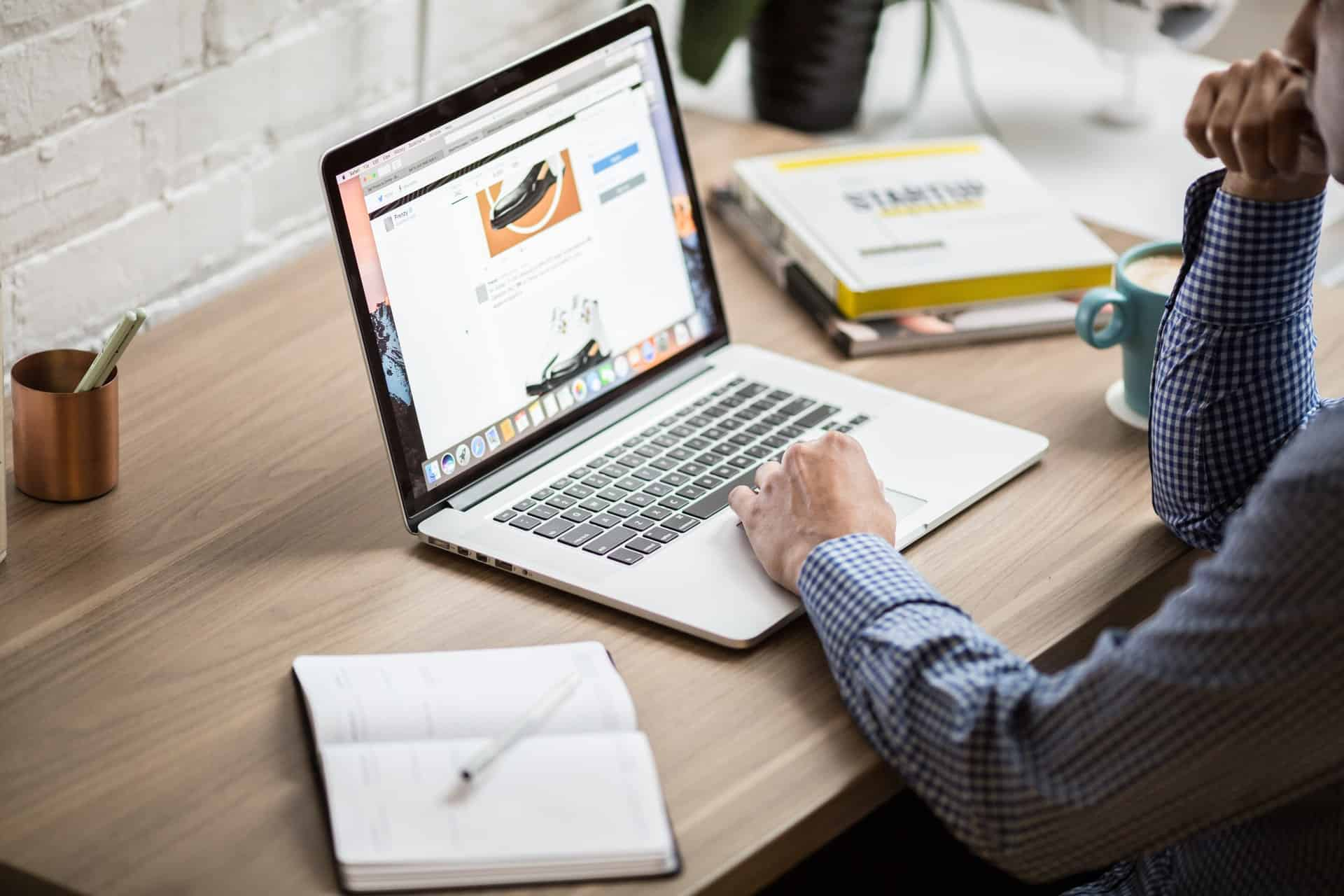 Man looking at product page