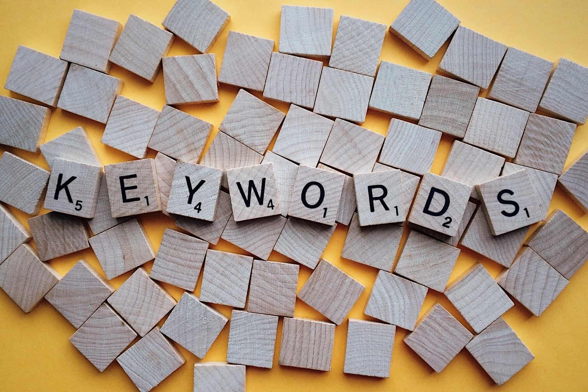 """Scrabble tiles spelling """"keywords""""."""