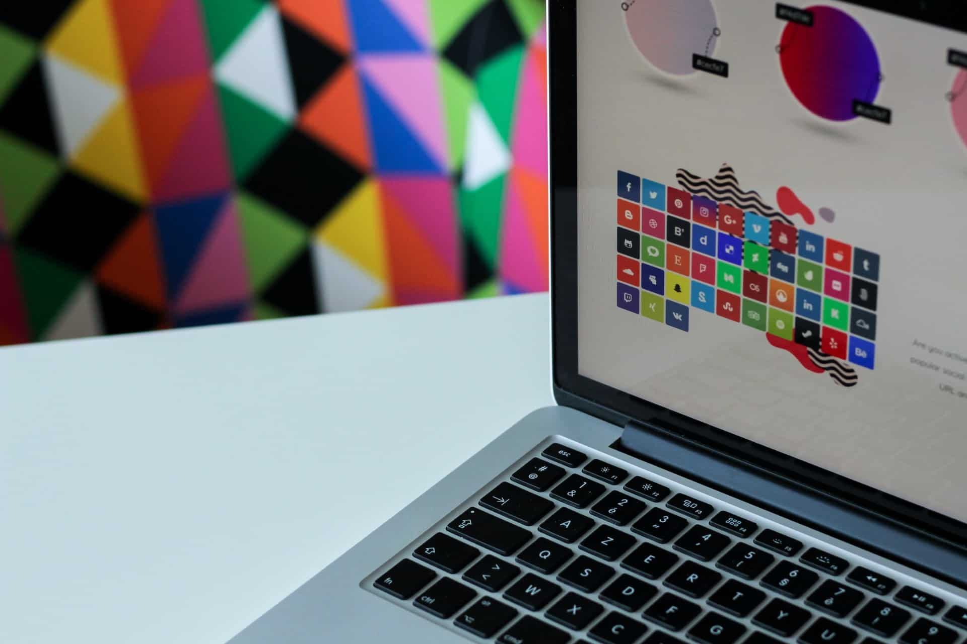 Laptop showing page with colorful design