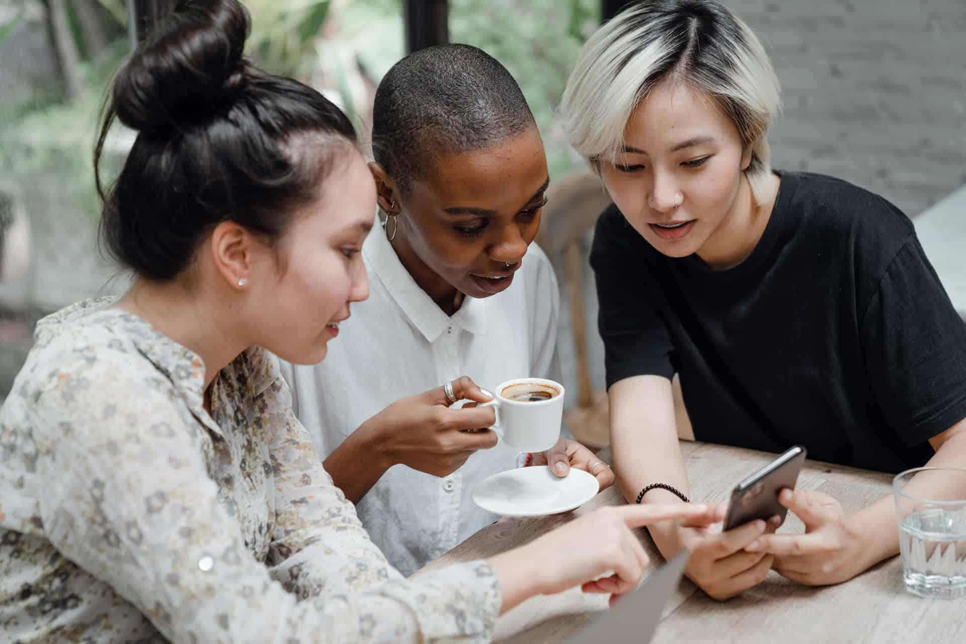 3 girls looking at phone