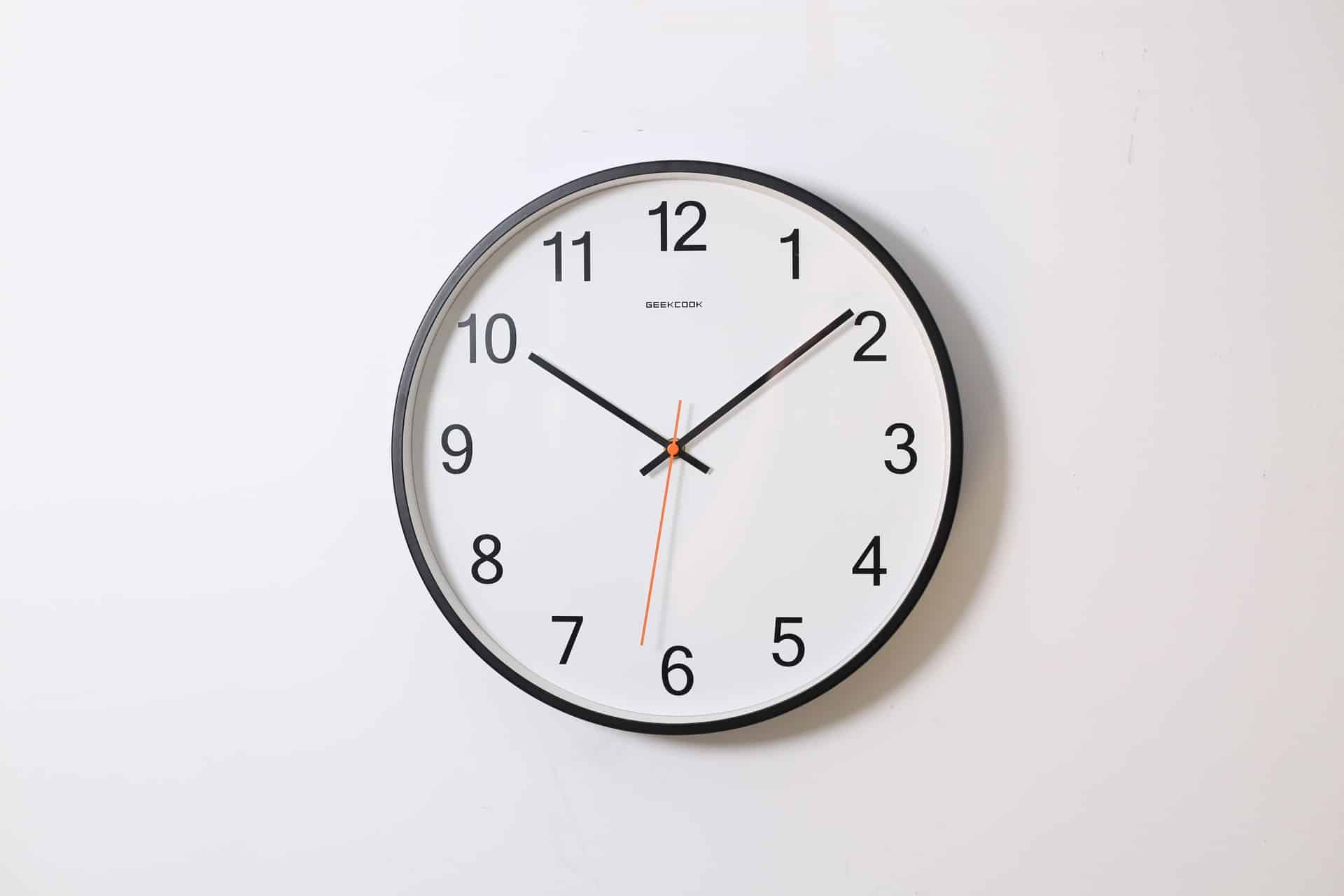 Plain clock on white wall