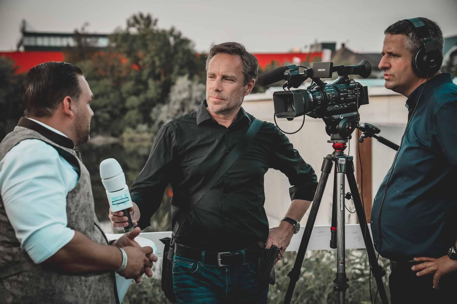 Man giving TV interview