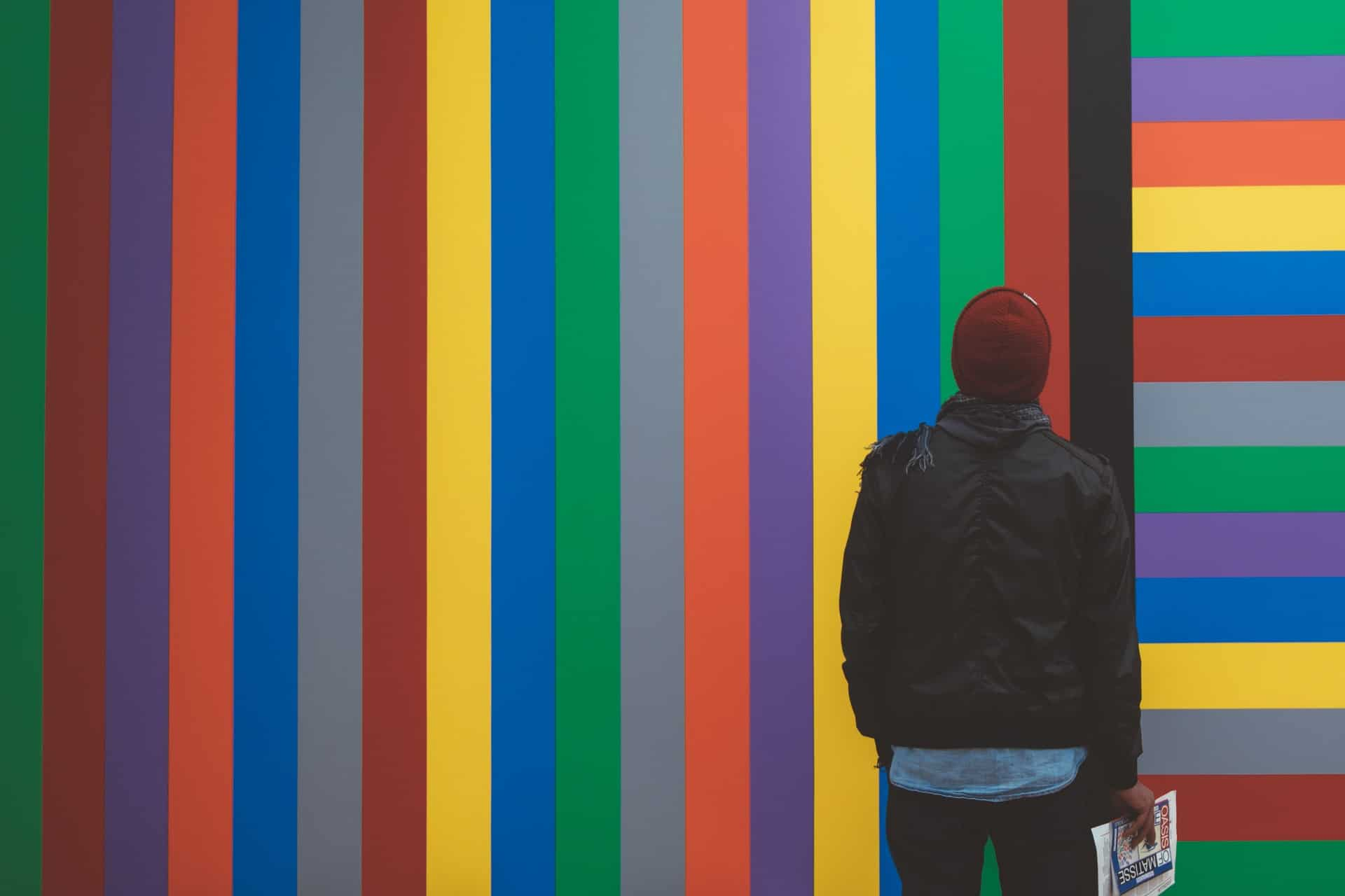 Man looking at colored wall